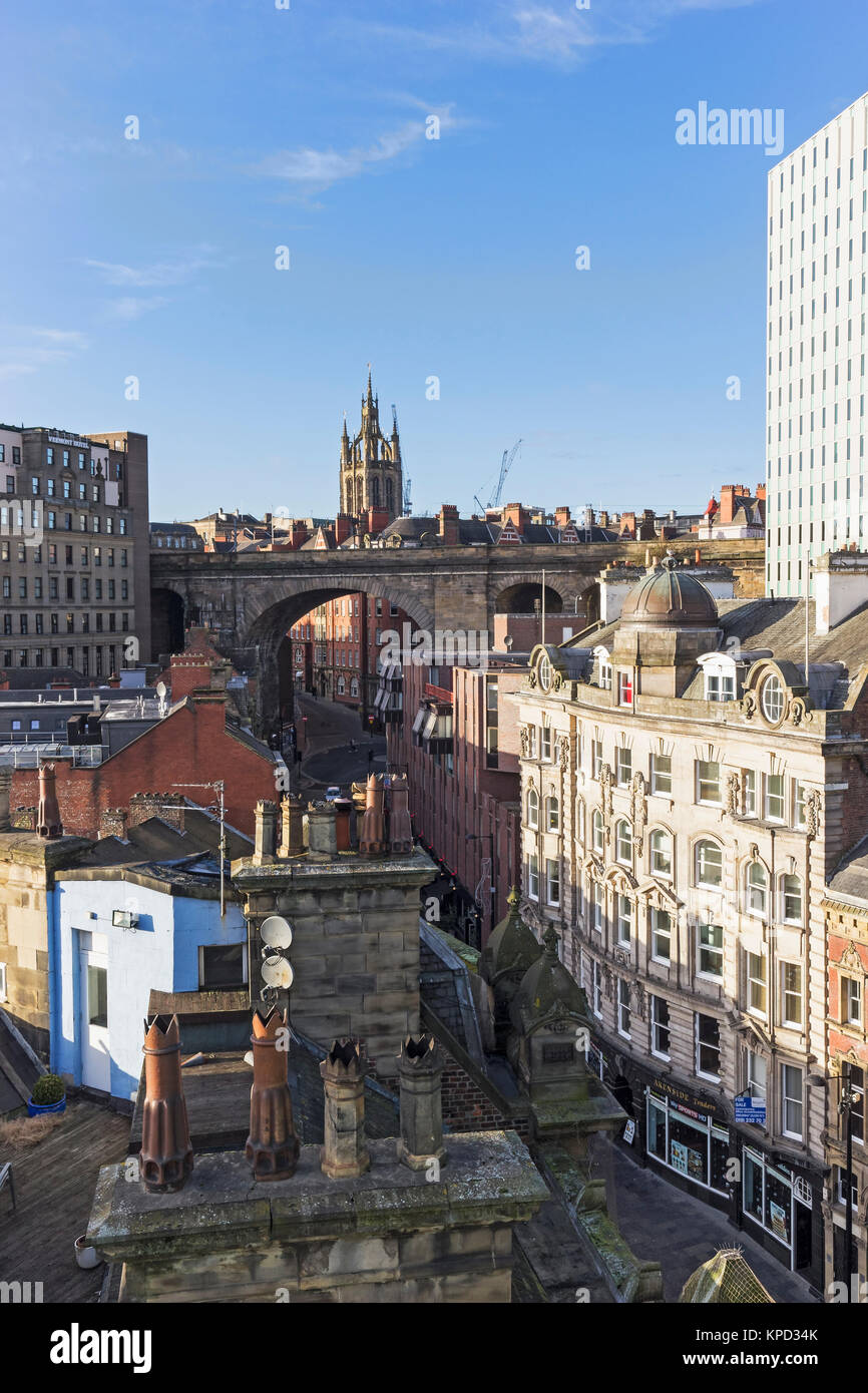 Architecture of Newcastle upon Tyne, UK from old chimney pots and the Railway Bridge to the art deco Cale Cross - Stock Image