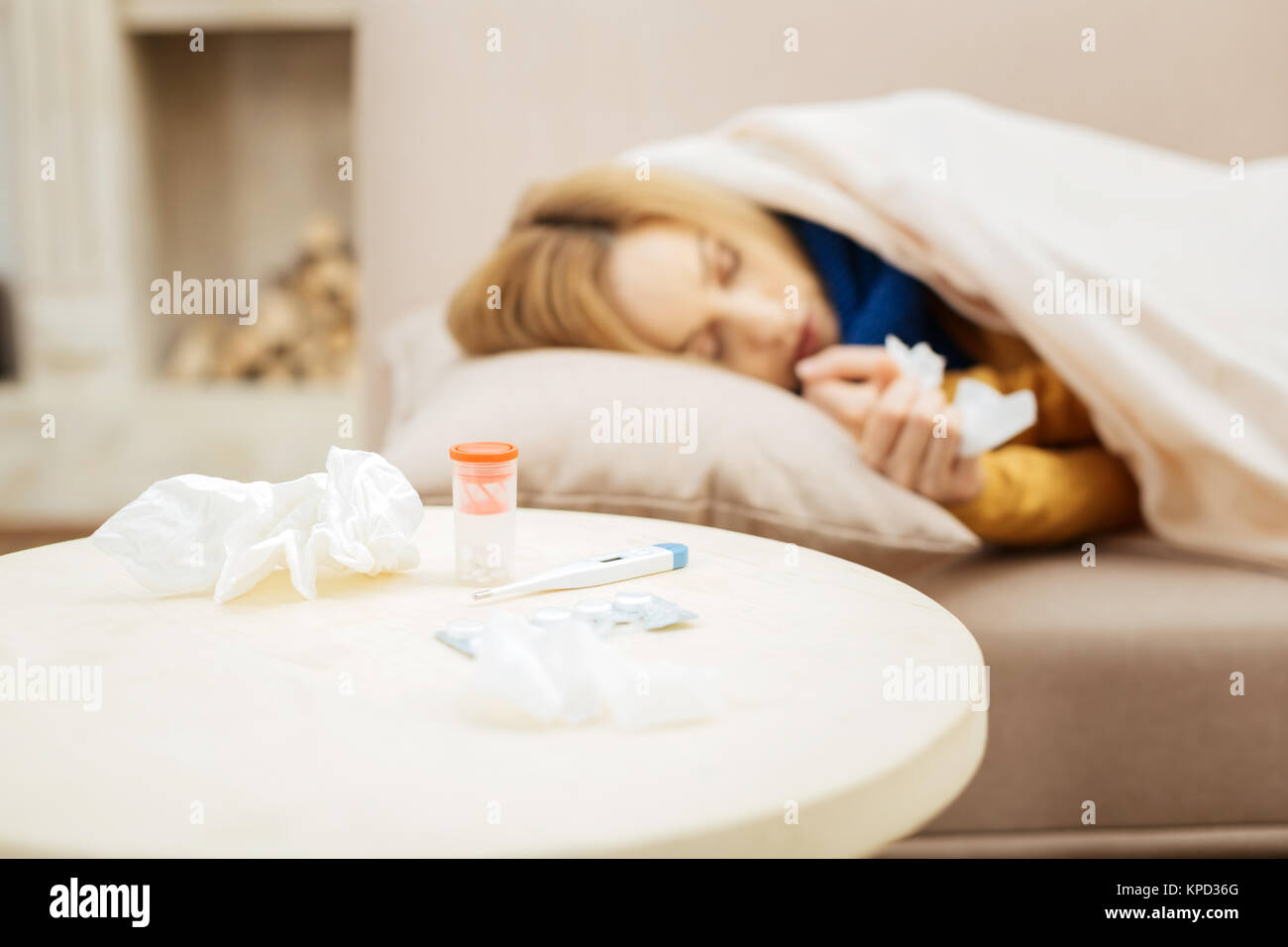 Unwell woman taking a nap to recover soon - Stock Image
