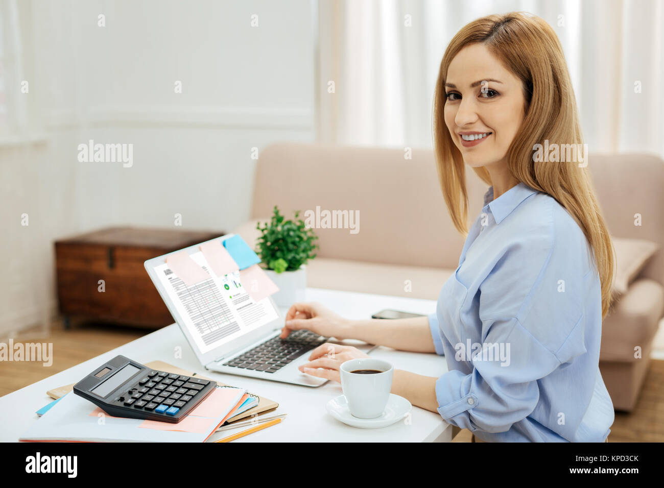 Inspired businesswoman working from home - Stock Image