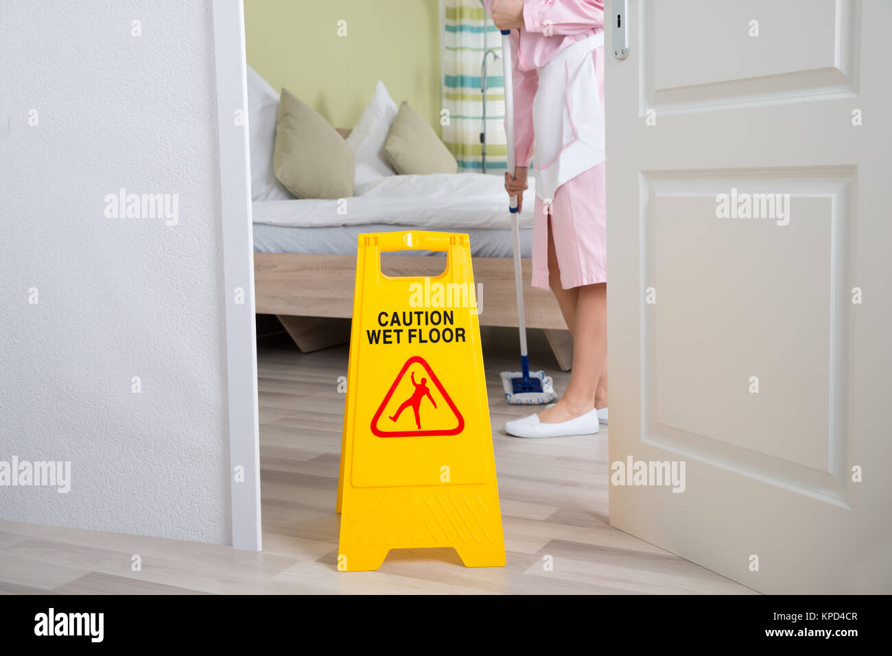 Female Housekeeper Cleaning Floor - Stock Image