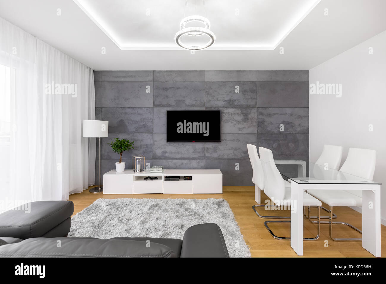 Bright Interior Of Living Room With Dining Space And Tv Screen Stock Photo Alamy