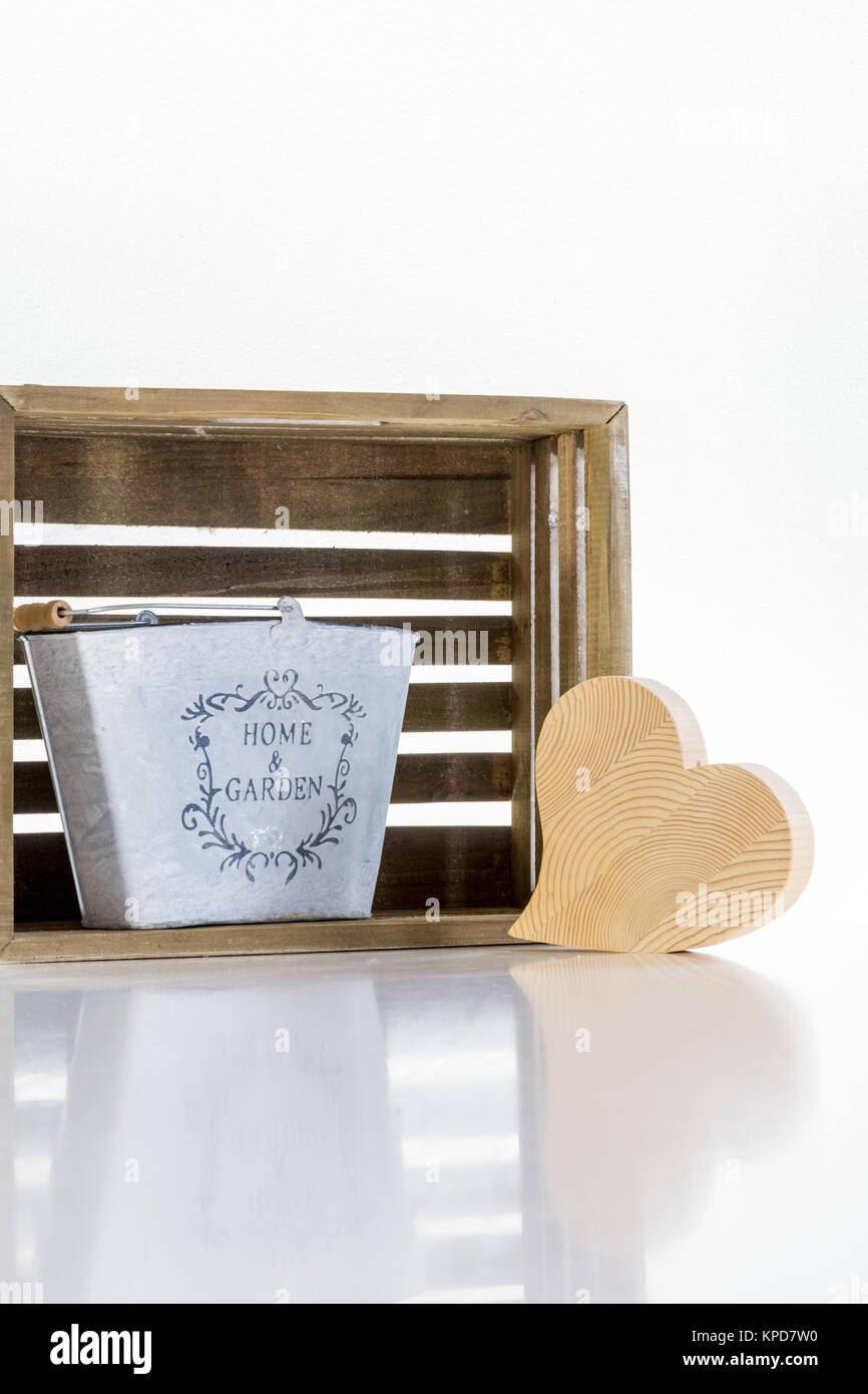 a metal bucket,a wooden heart and a box,home and garden purist - Stock Image