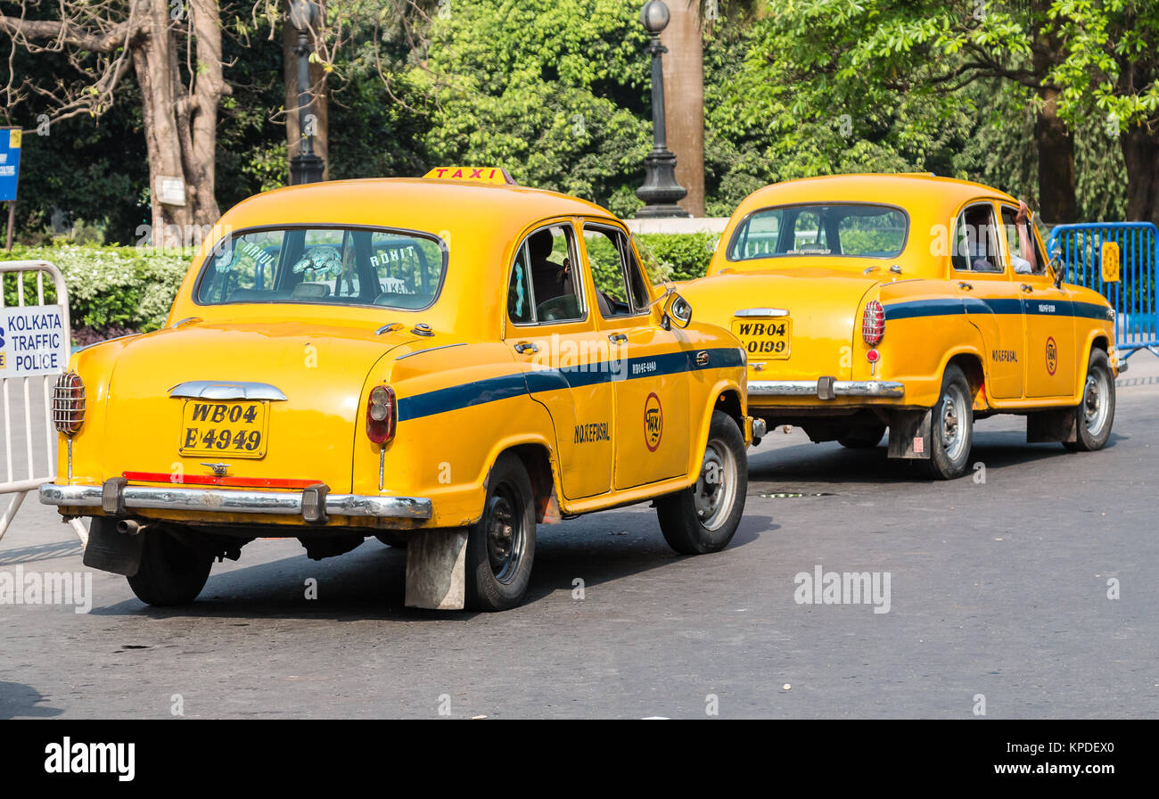 Iconic yellow indian taxi in Calcutta.  The Ambassador tax vehicle is no longer being built. - Stock Image