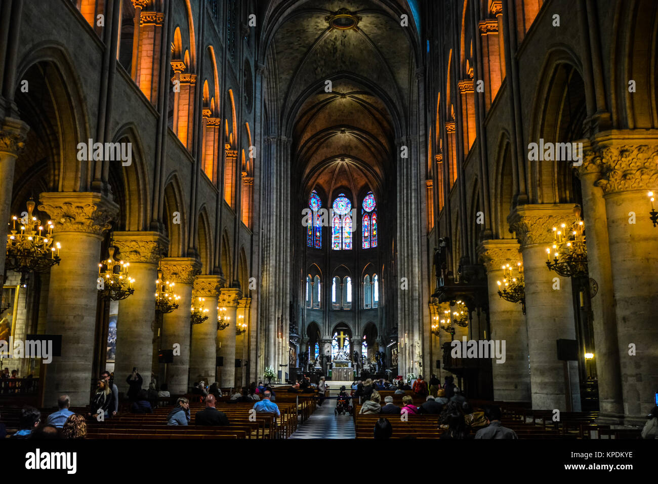 The gothic interor, nave and pews of the medieval cathedral, Notre Dame de Paris on the Ile de la Cite in Paris - Stock Image