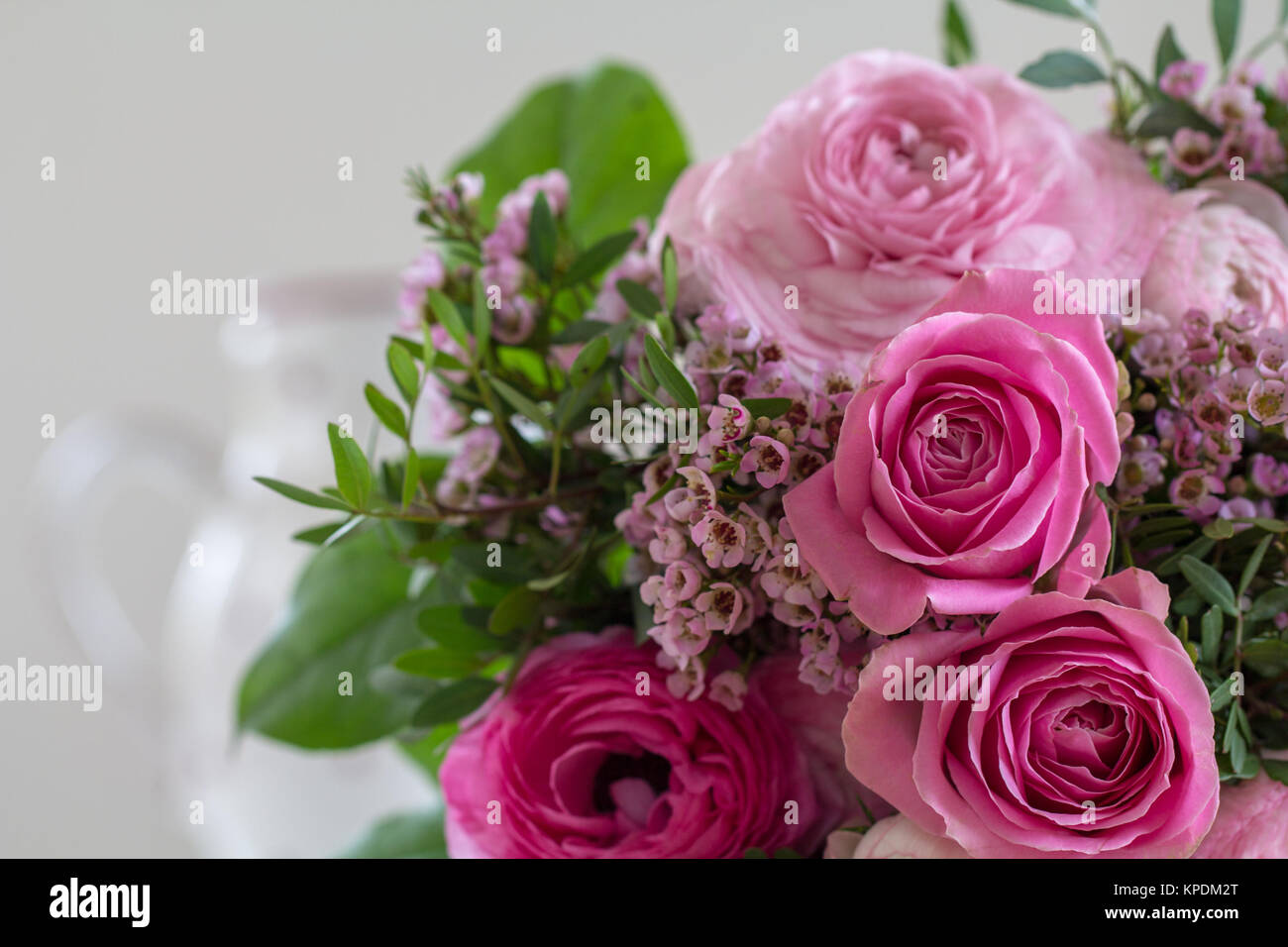 a great rose bouquet in rose tones is waiting on the table and waiting to be given away - Stock Image