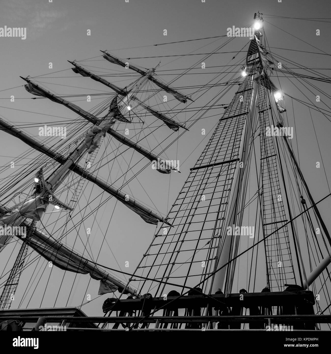 A two-masted sailing ship laying at quay in Olbia marina, Sardinia, Italy - Stock Image