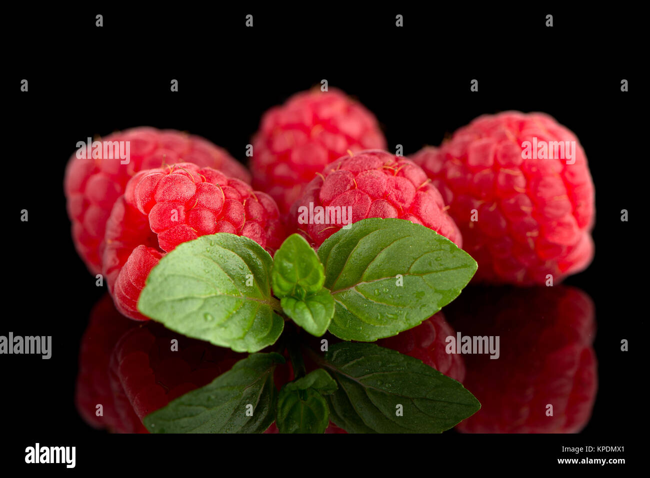 Raspberries with leaves - Stock Image