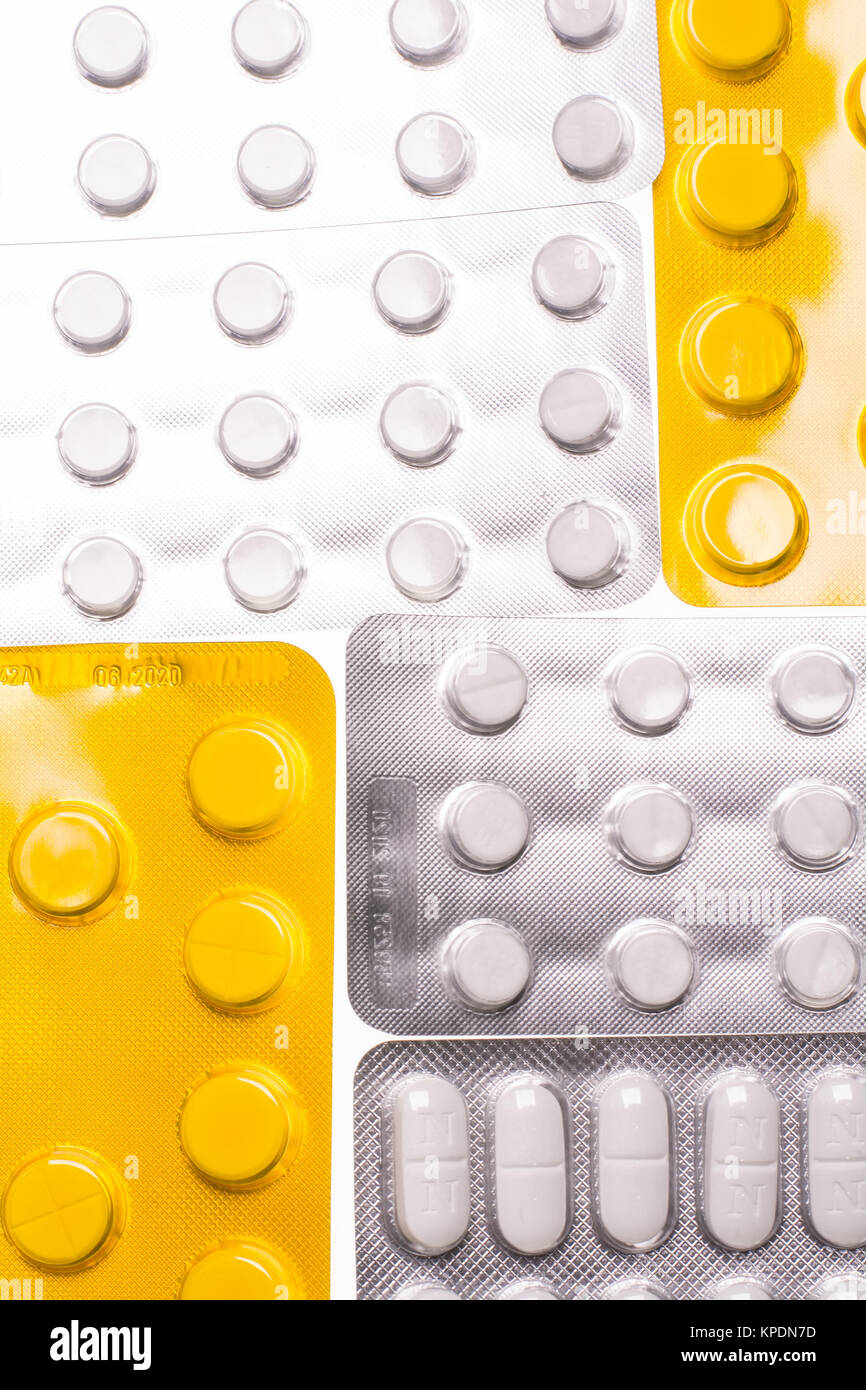 Blisters with pills on a white background for the treatment of diseases - Stock Image