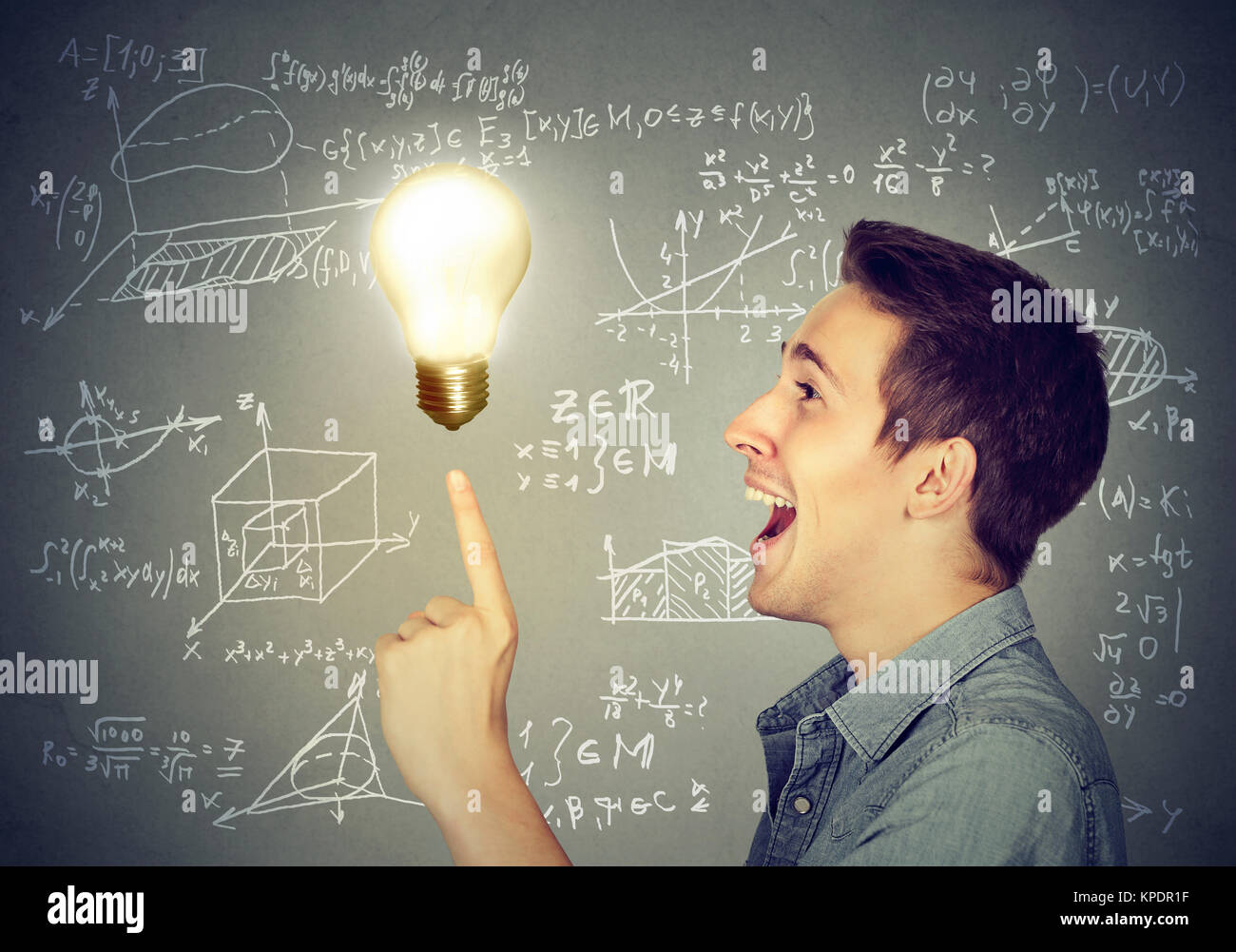 Side view of content man having great problem solution posing with burning light bulb. - Stock Image