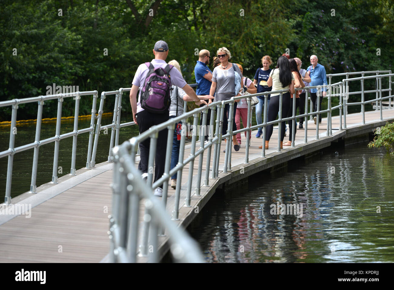 People walking along the redeveloped Regent's Canal Towpath, Kings Cross, London. - Stock Image