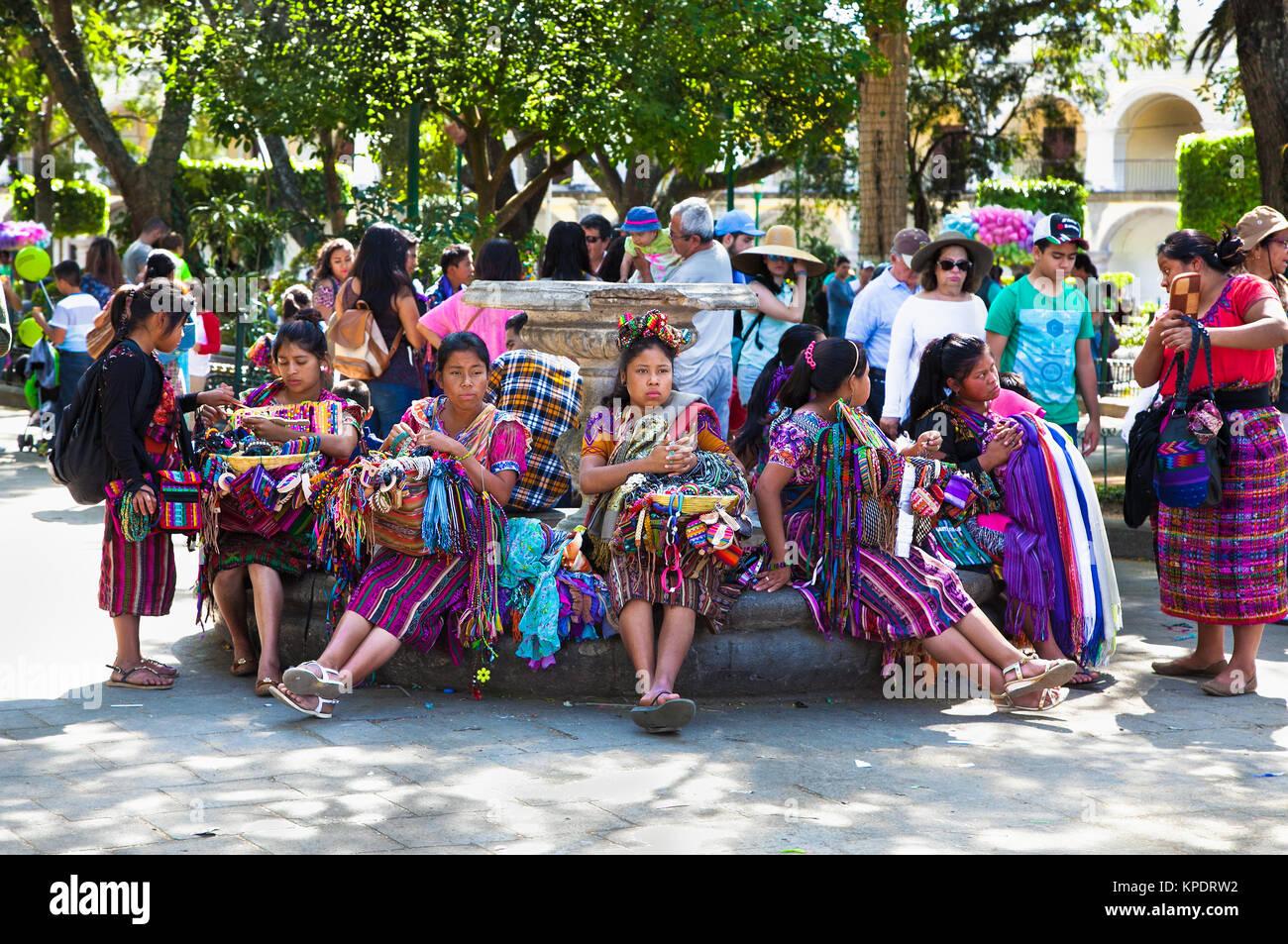 ANTIGUA, GUATEMALA-DEC 27, 2015: : Guatamalian woman salling traditional  colorful fabric and goods at the street - Stock Image