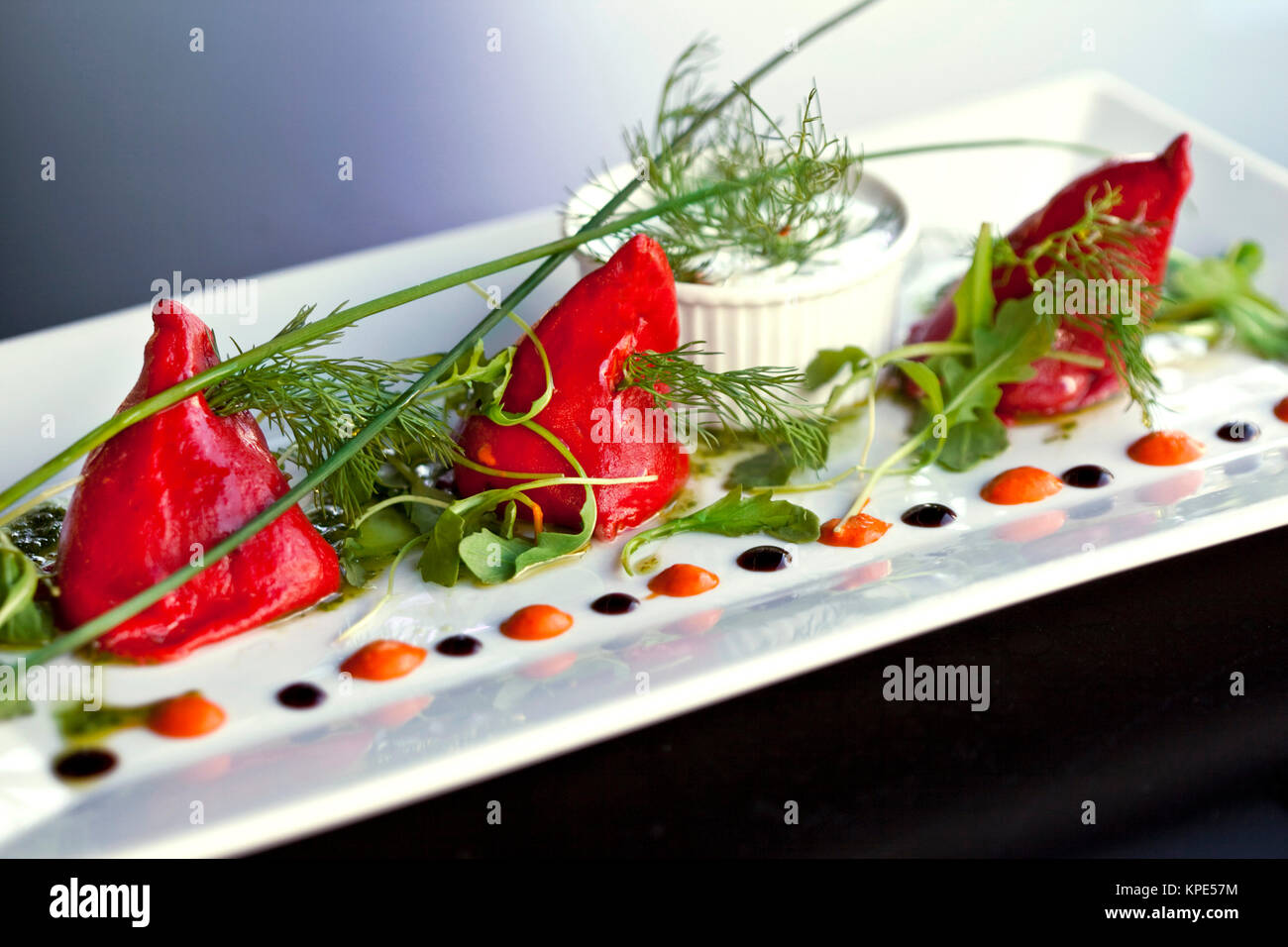 Cod and peppers on a plate - Stock Image