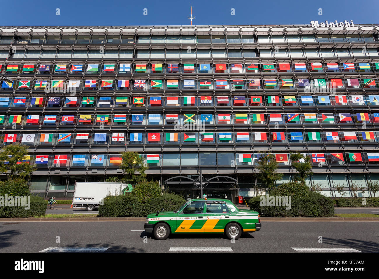 The Offices of the Mainichi Newspaper Company display all 206 flags of the countries taking part in the 2020 Tokyo Stock Photo