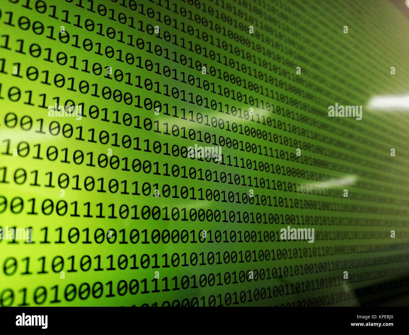 computer screen with binary codes on monitor  abstract