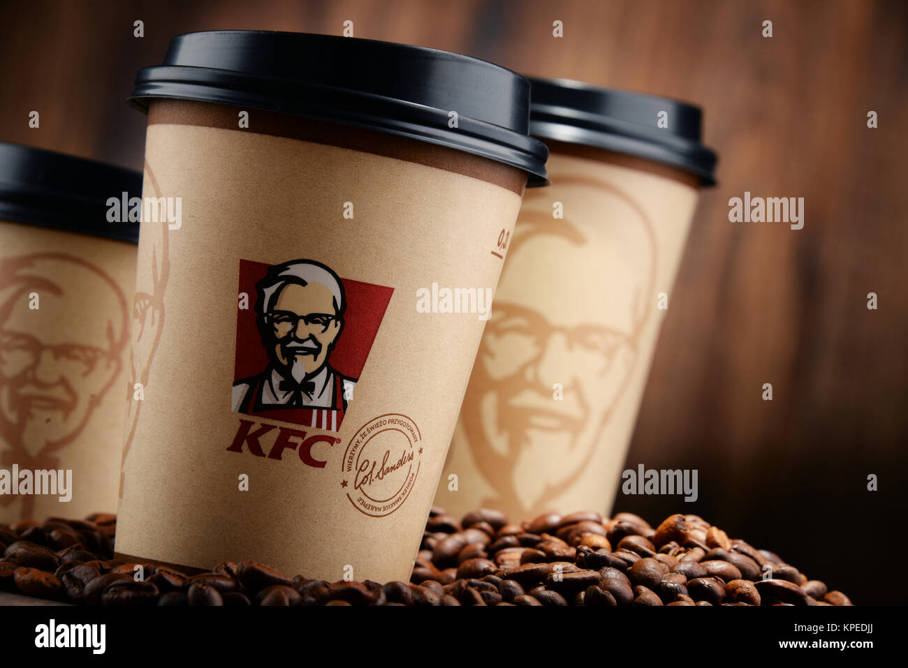 Composition with KFC coffee cup and beans - Stock Image