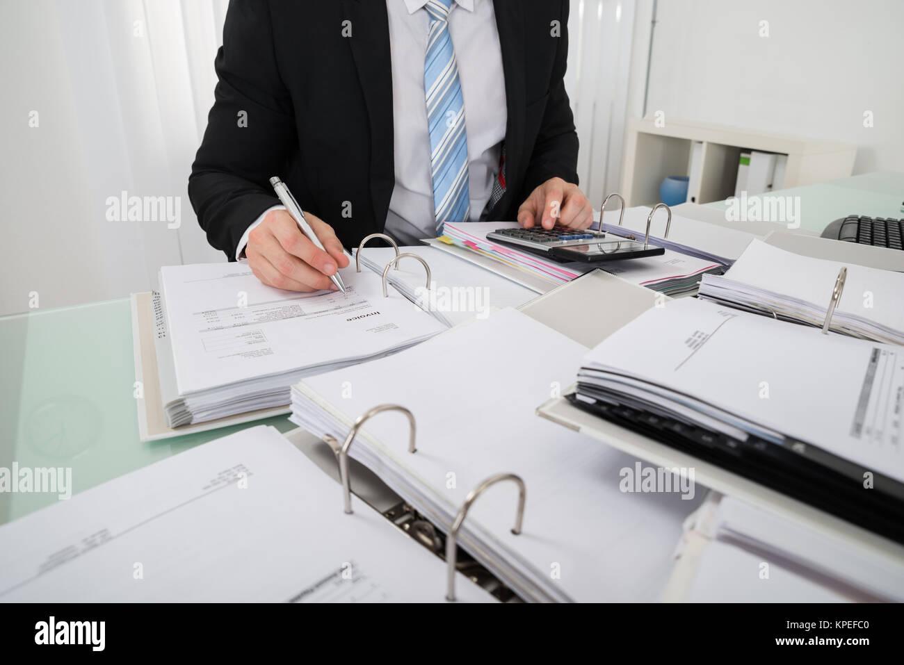 Businessman Calculating Bill Stock Photo