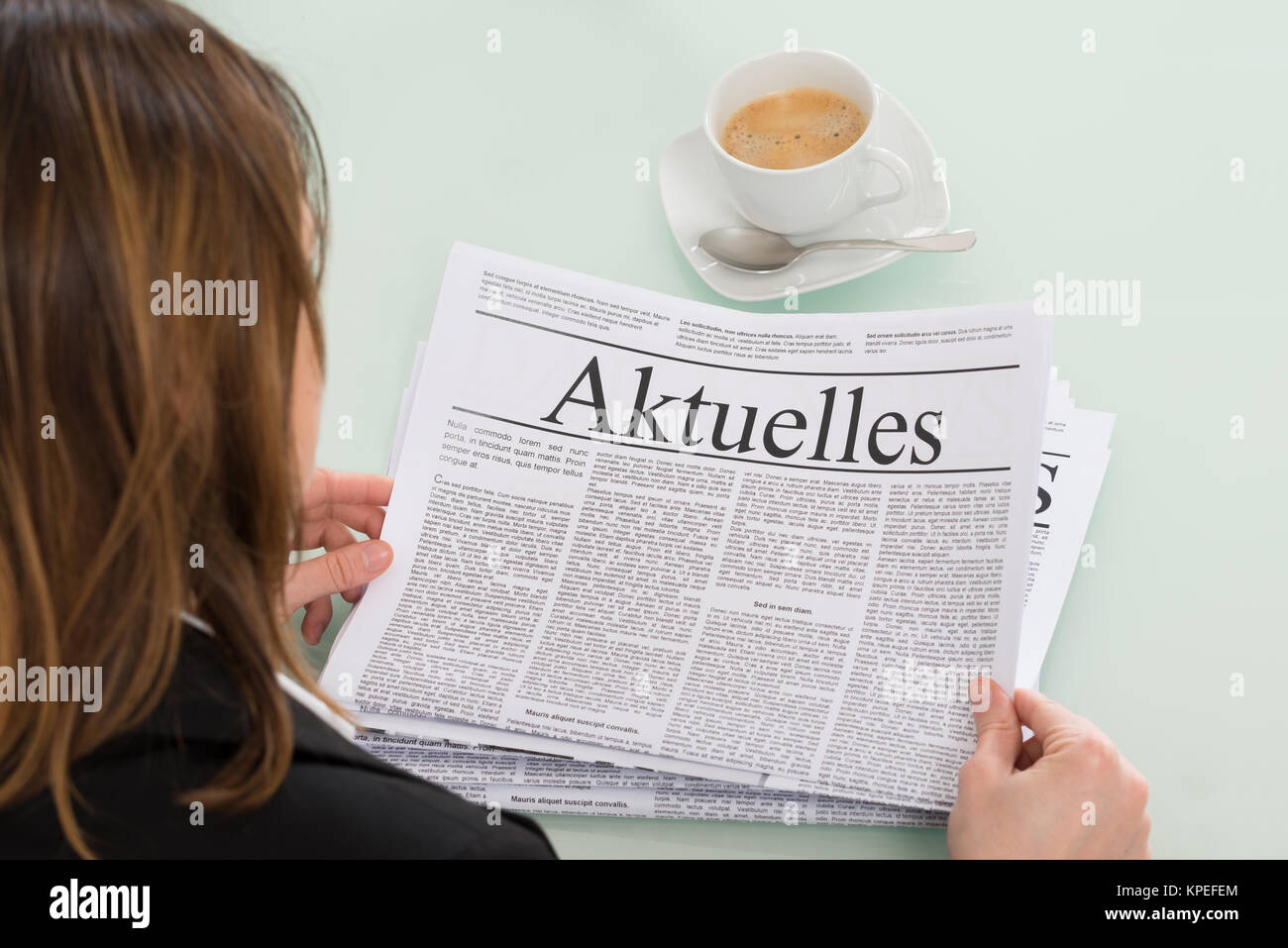 Close-up Of Businesswoman Reading Newspaper - Stock Image