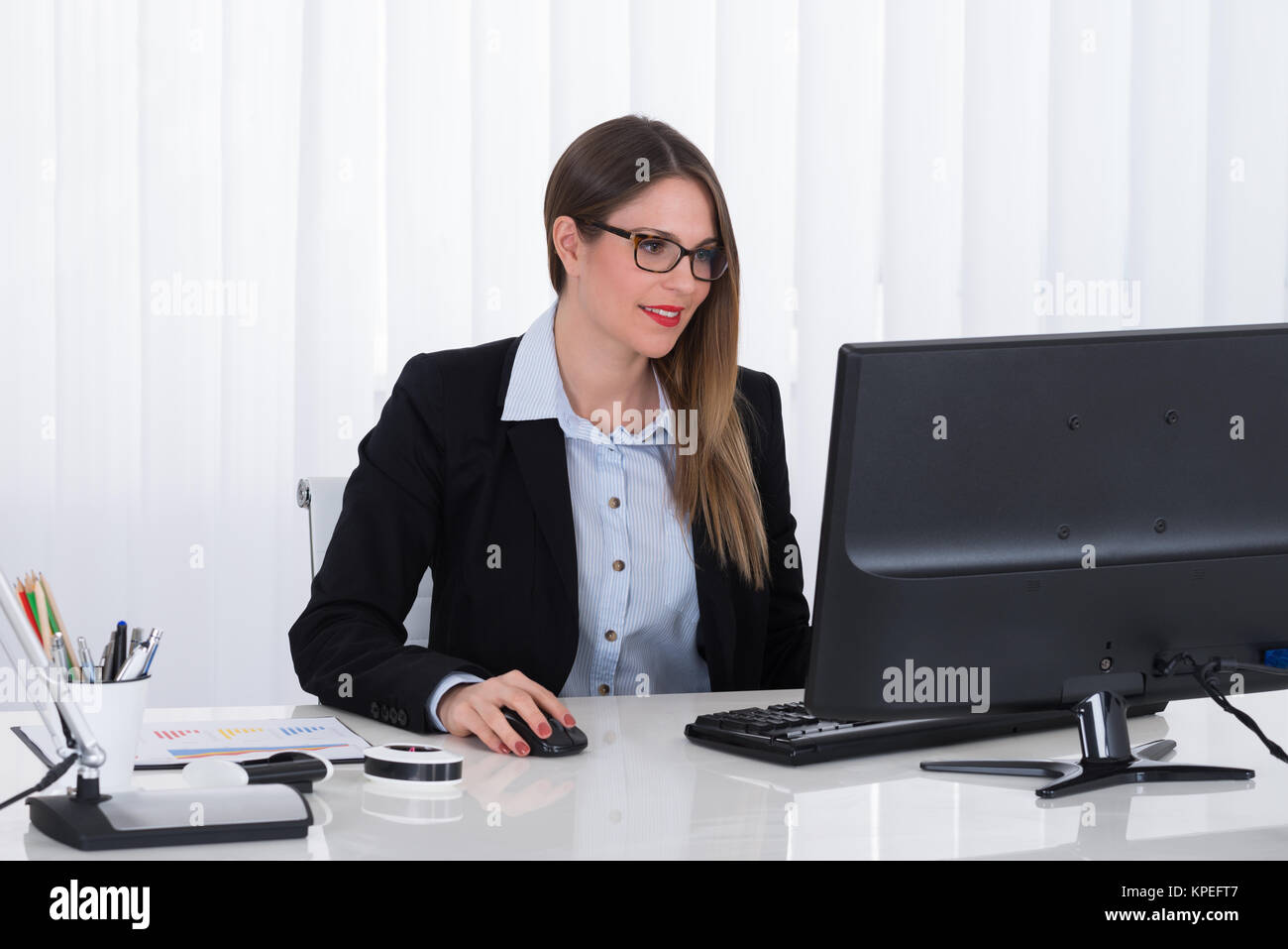 Businesswoman Using Computer - Stock Image