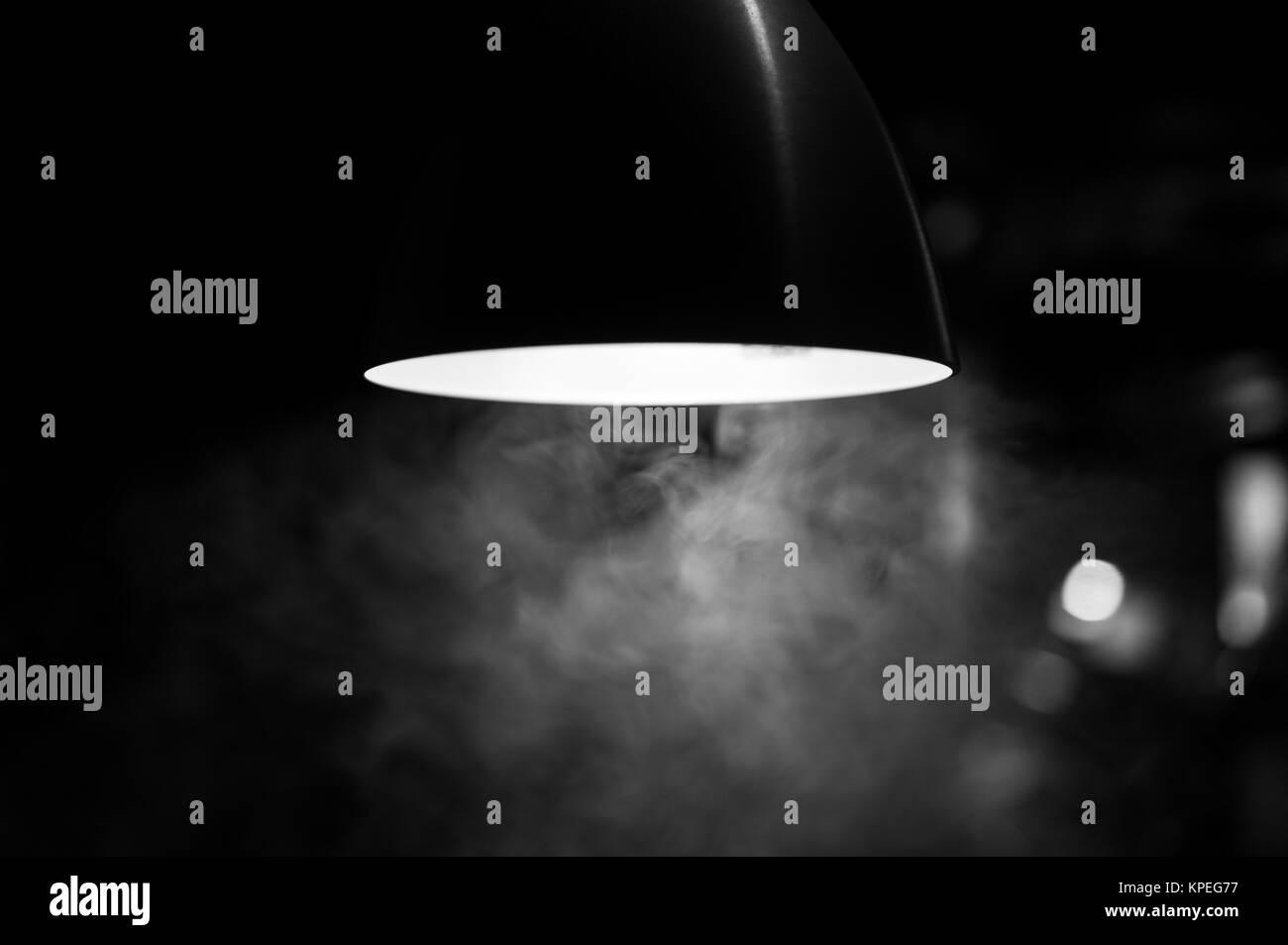Smoke under the light - Stock Image