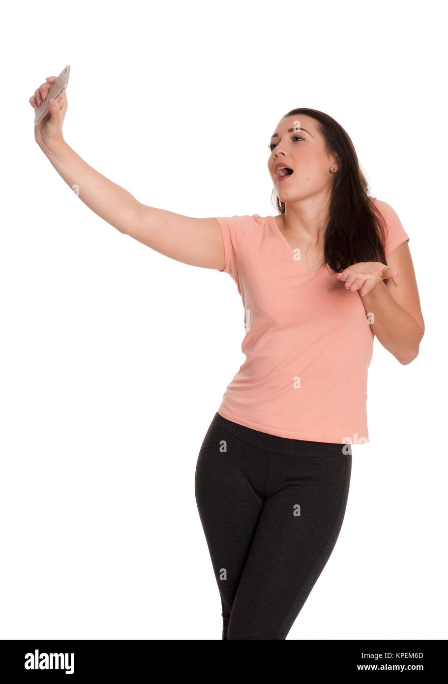 young woman singing loudly and makes a selfie - Stock Image