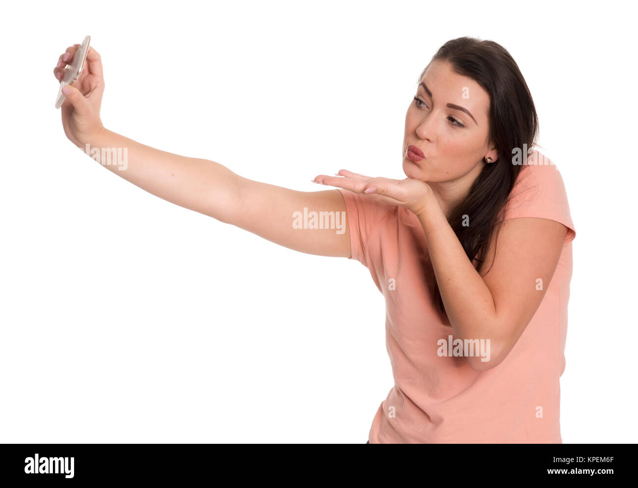 young woman showing a pout and makes a selfie - Stock Image