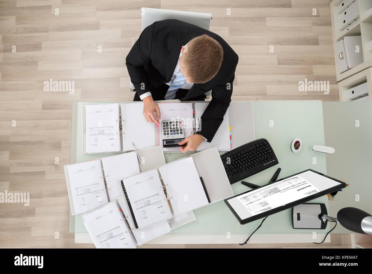 Businessman Checking Tax - Stock Image
