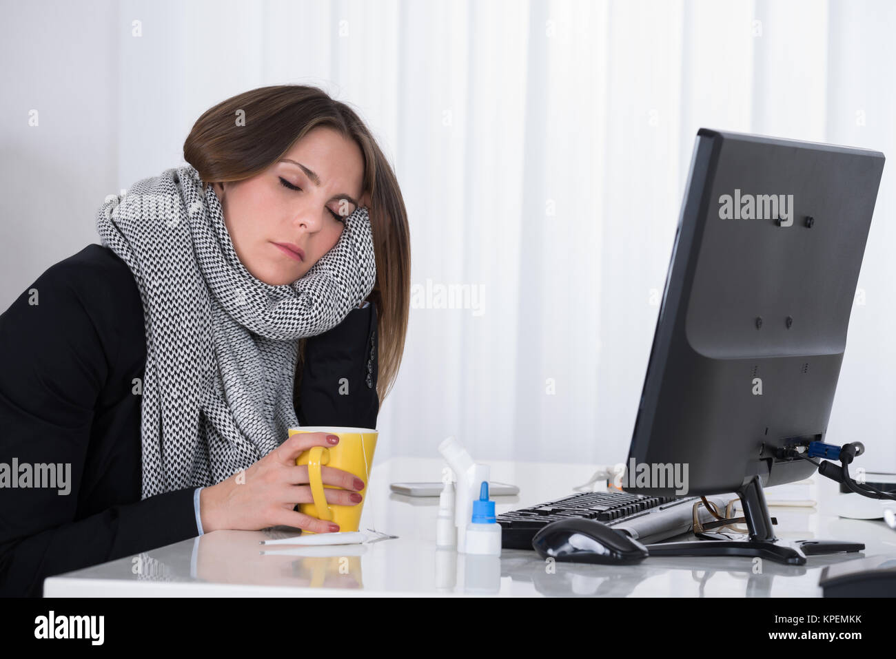 Businesswoman With Cup At Desk - Stock Image