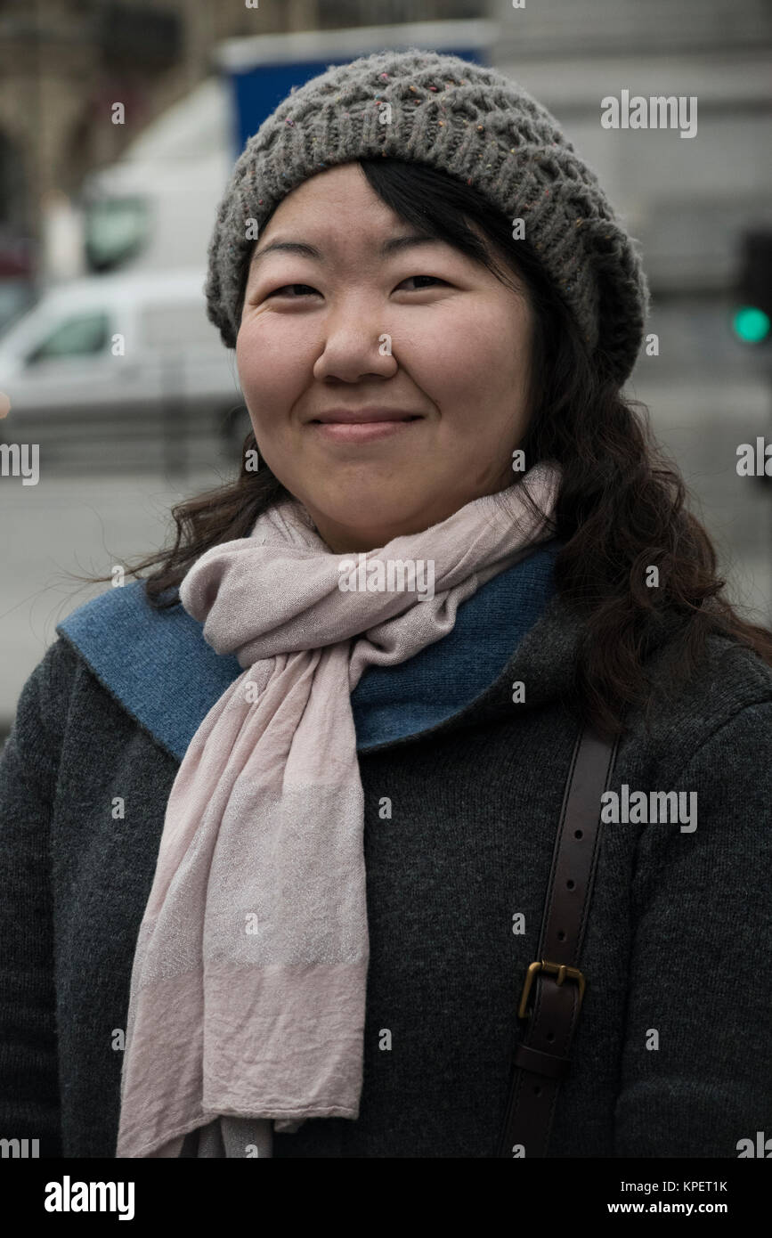 Paris, France. Smiling lady wearing midwinter clothes - Stock Image