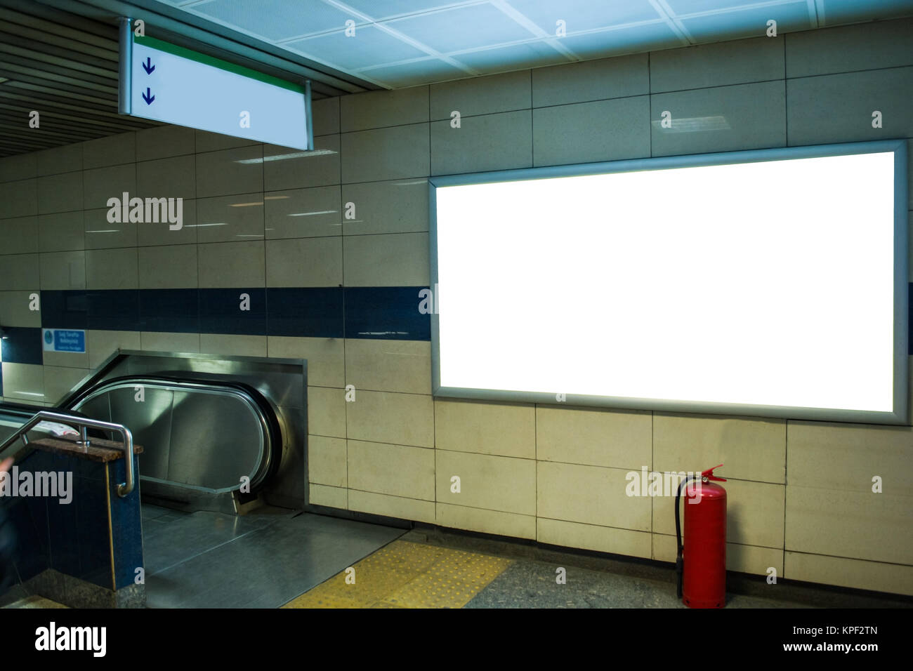 blank horizontal big poster in public place billboard mockup near to escalator in subway - Stock Image