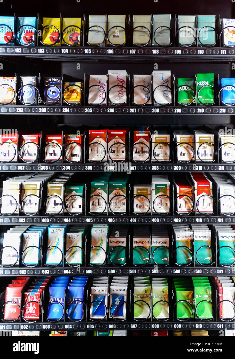 A modern Cigarette Machine with various brnads of cigarettes on display for sale - Stock Image