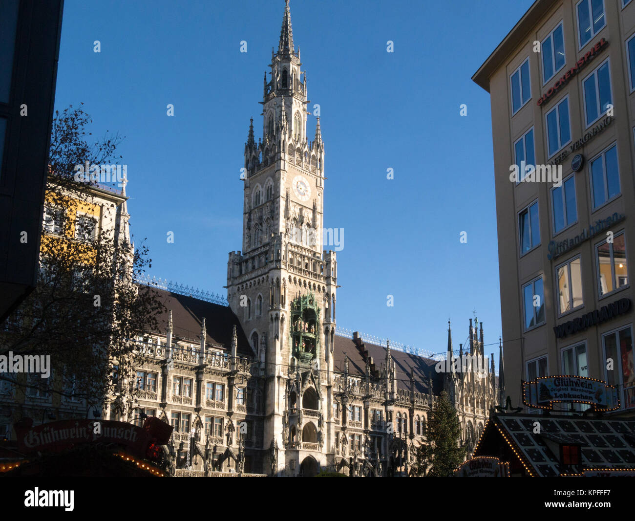 Christmas market stalls in front of Rathaus New Town Hall in Marienplatz Munich Bavaria Germany EU - Stock Image