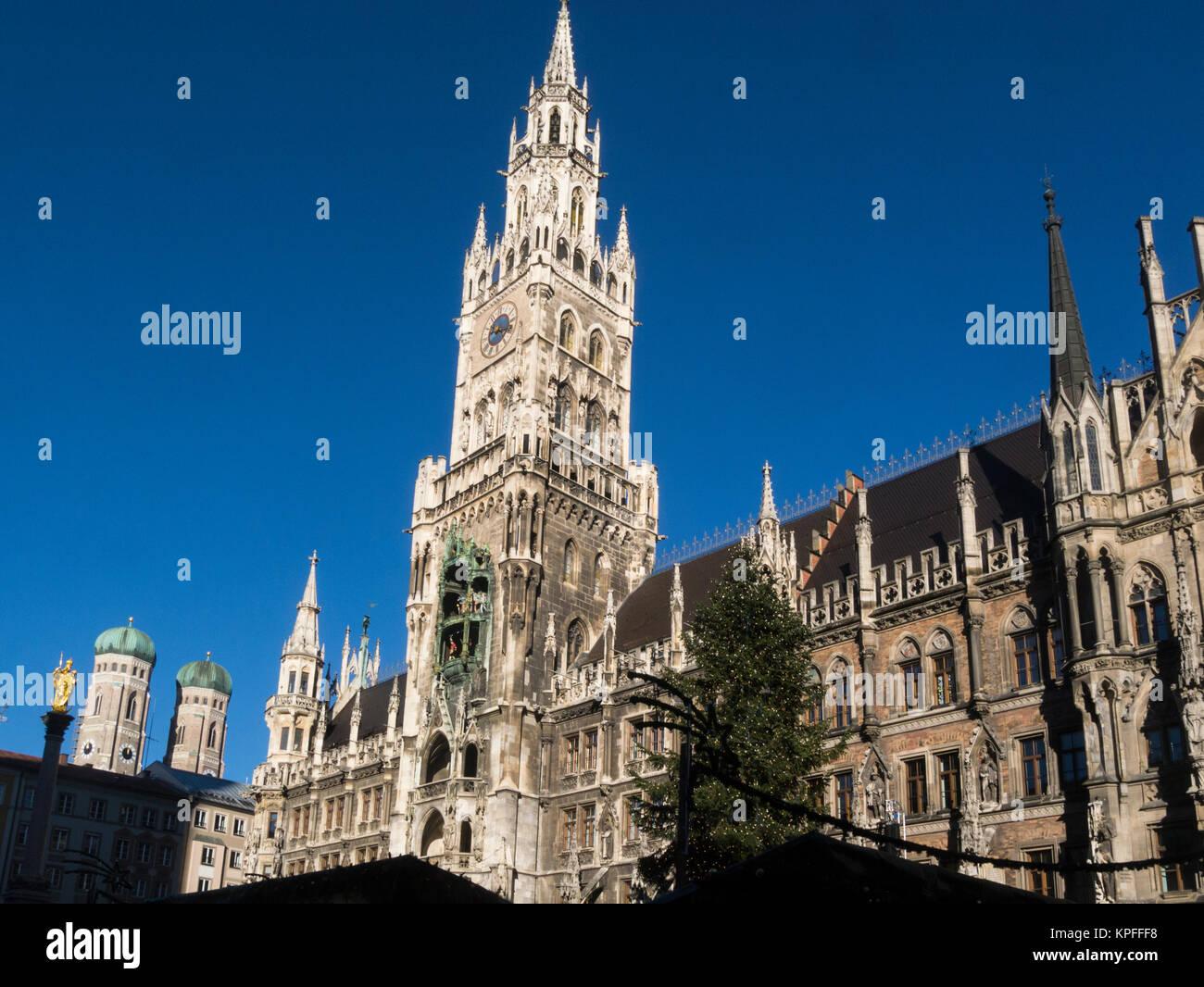 Magnificent Rathaus New Town Hall building and spires of Frauenkirche Marienplatz Munich Bavaria Germany EU - Stock Image