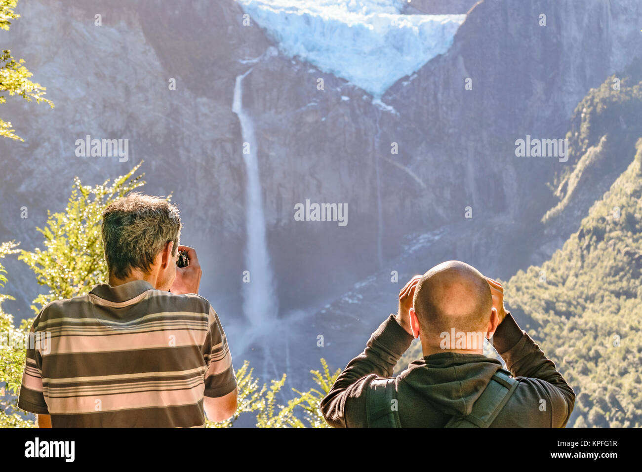 Men taking photos of glacier at queulat park, patagonia, chile - Stock Image