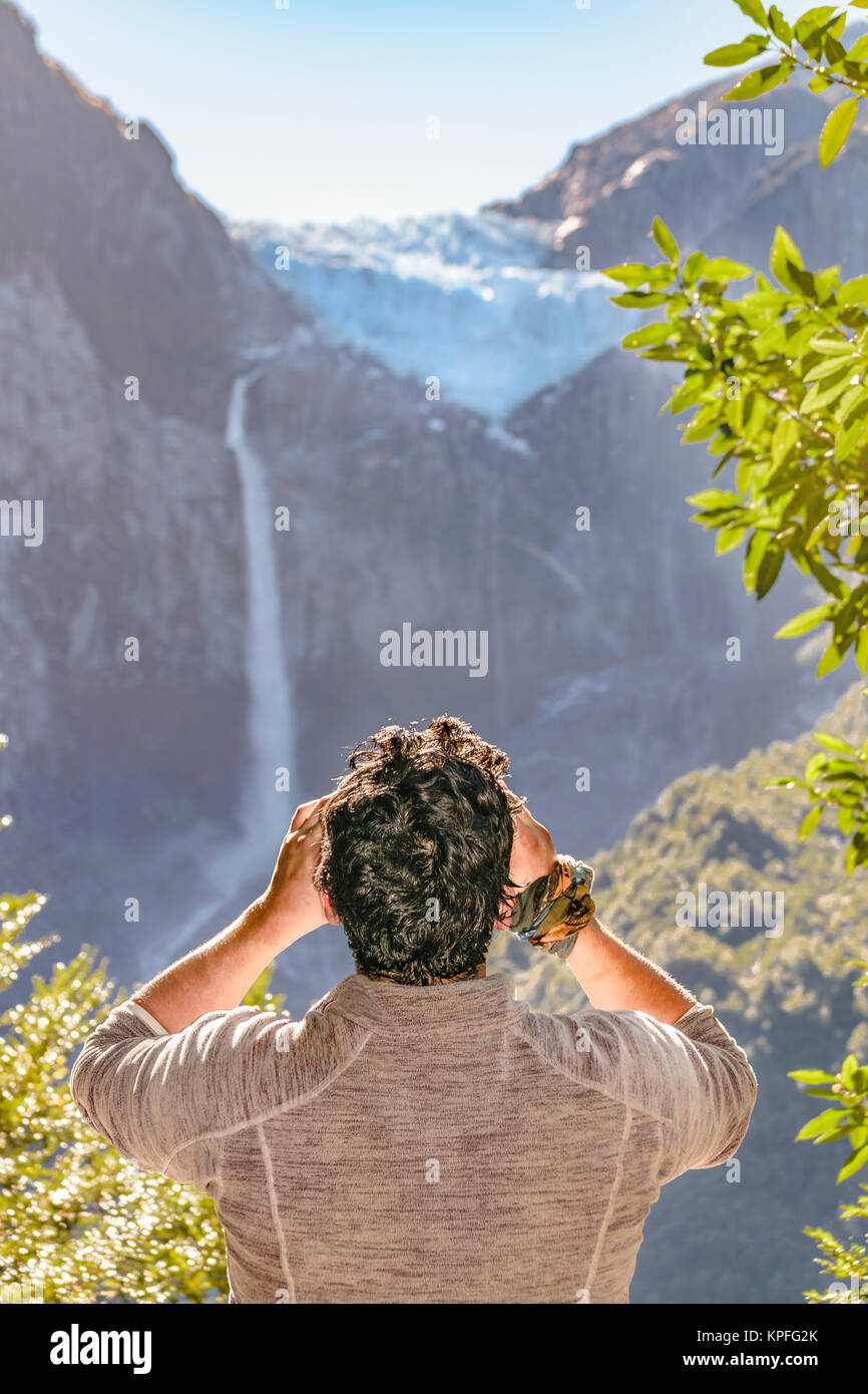 Man taking photos of glacier at queulat park, patagonia, chile - Stock Image