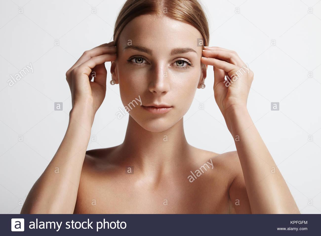 woman touching her hair - Stock Image