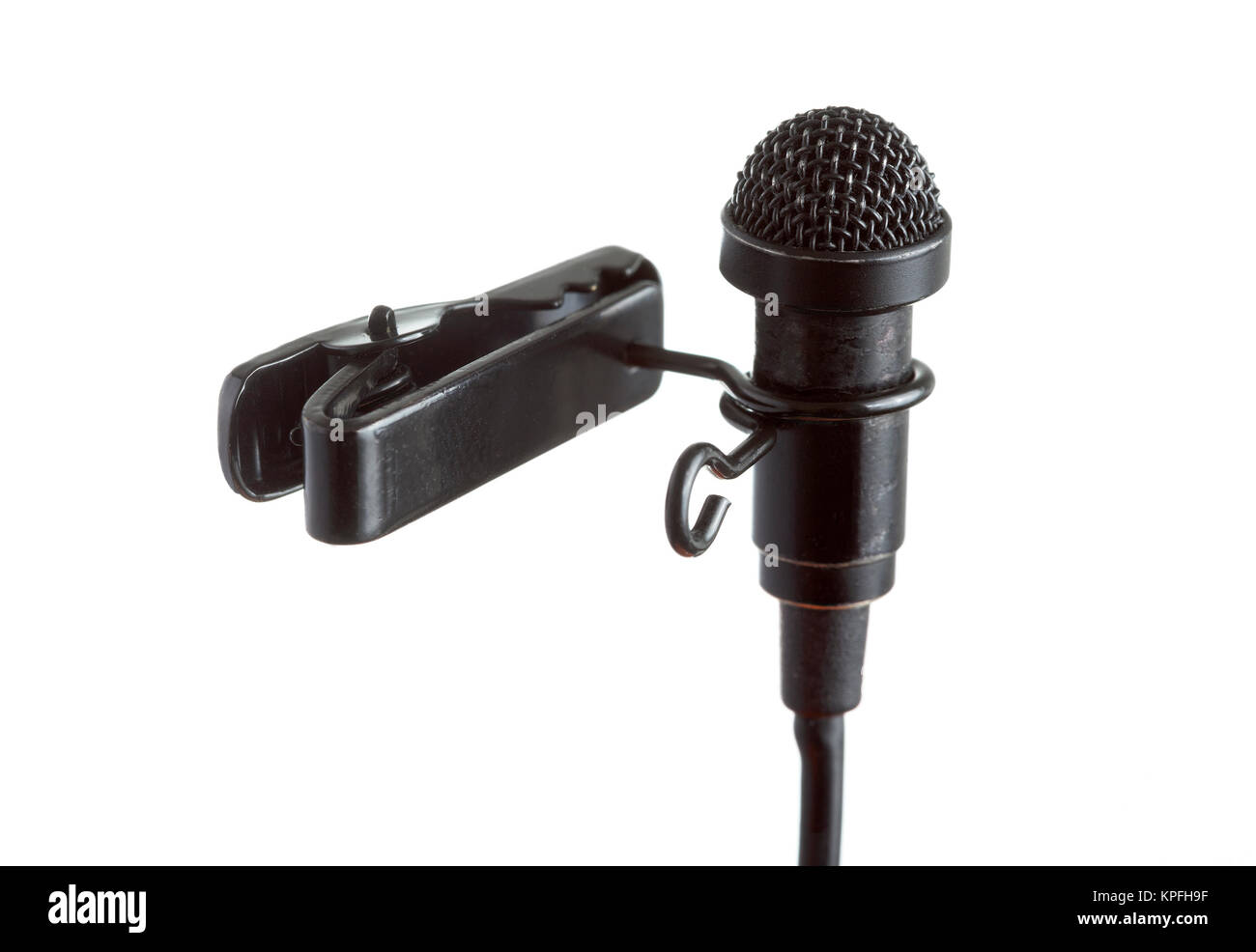 Close-up of a tie-clip microphone with a white background - Stock Image
