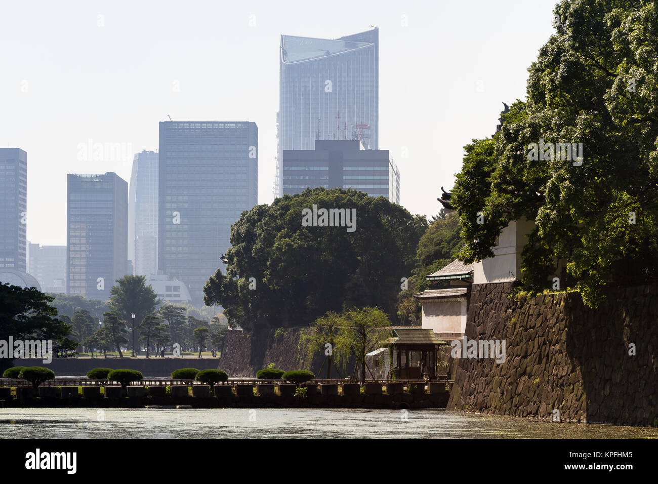 Tokyo skyscrapers seen behind the Imperial Palace walls and Palace moat in central Tokyo, Japan. Friday October - Stock Image
