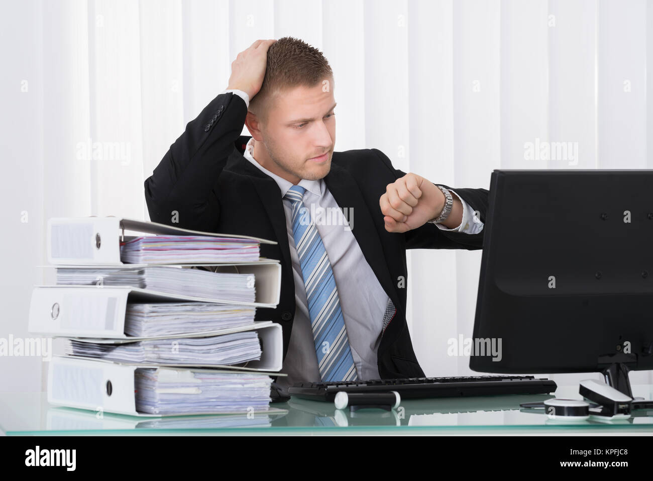 Businessman Looking At Watch - Stock Image