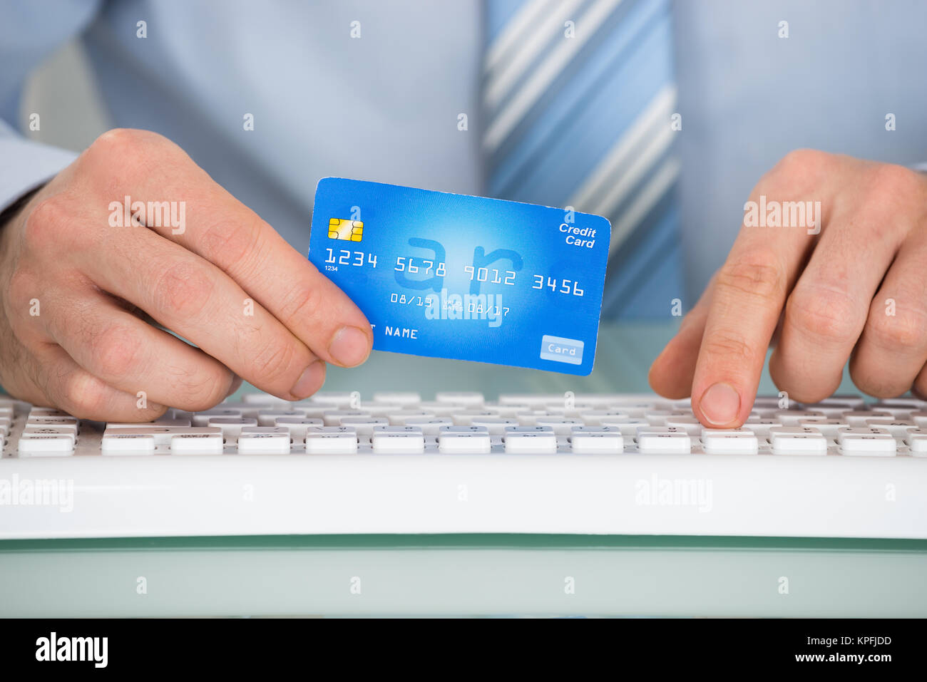 Businessperson With Credit Card And Keyboard - Stock Image