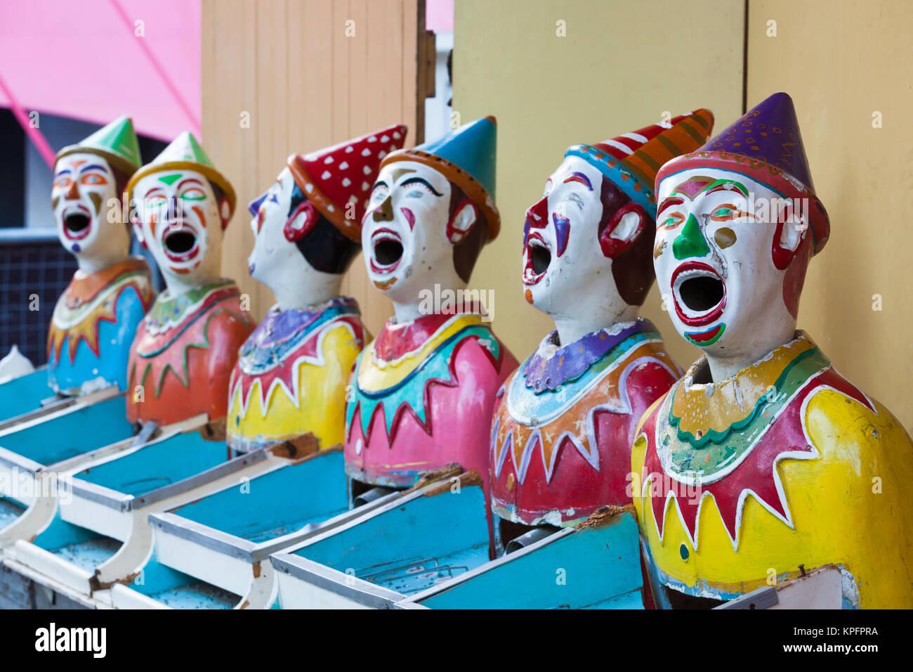 Australia, Adelaide, Rundle Park, clown heads at water gun arcade - Stock Image