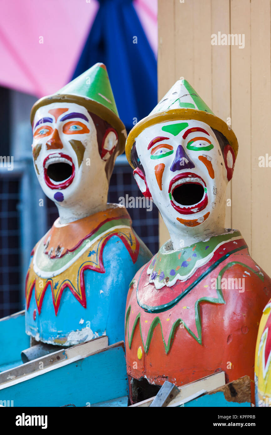 Australia, Adelaide, Rundle Park, The Garden of Unearthly Delights, clown heads at water gun concession - Stock Image