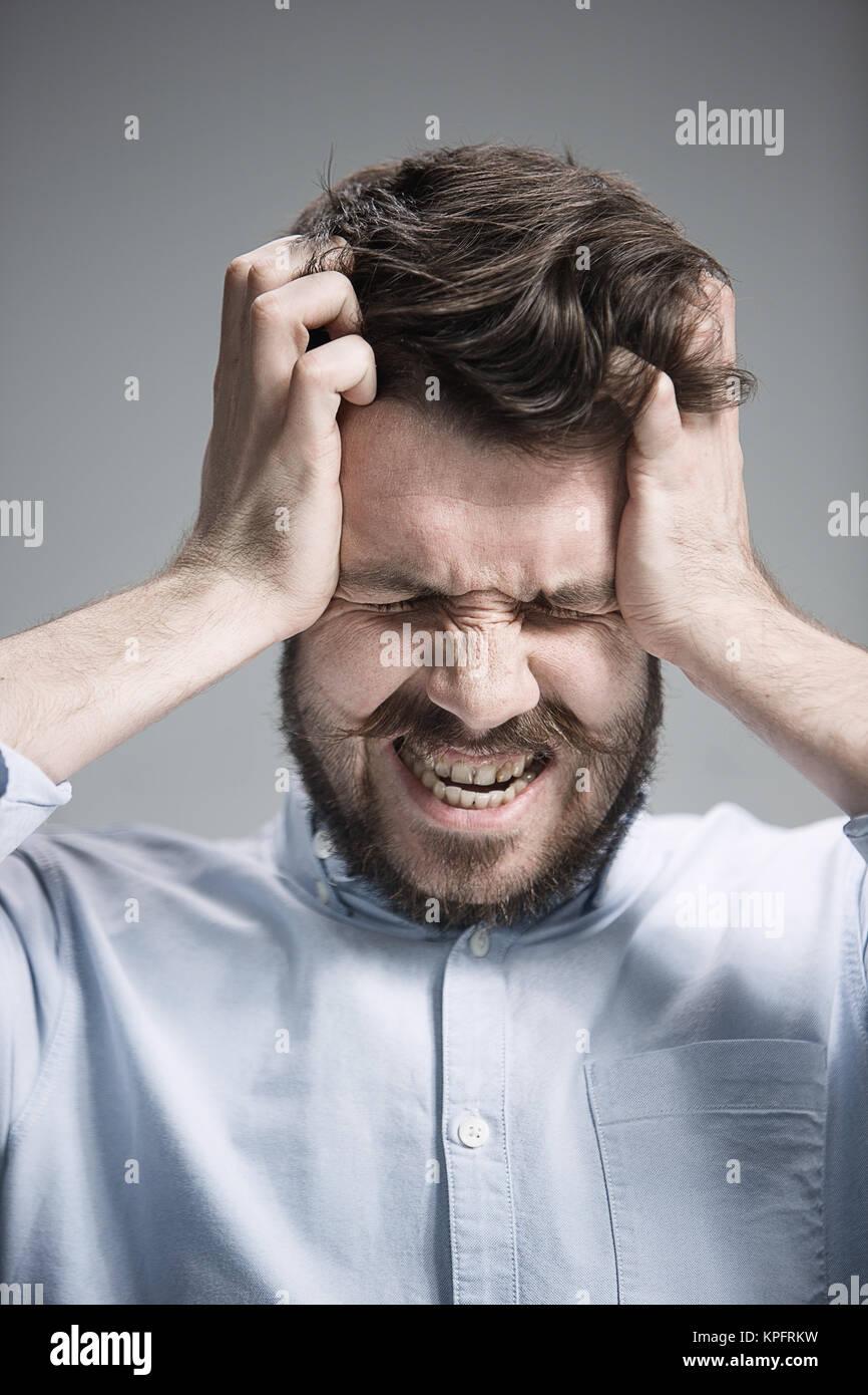 Close up face of desperate man - Stock Image