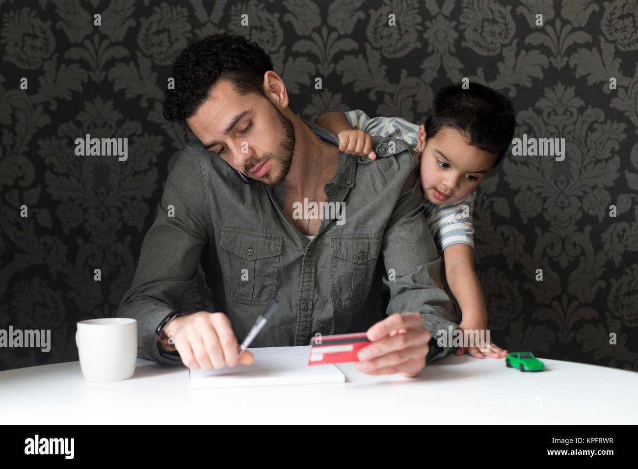 African American Dad And Son Shopping Stock Photos & African