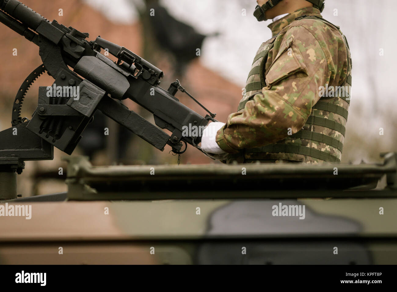 Armed soldiers take part at a military parade - Stock Image