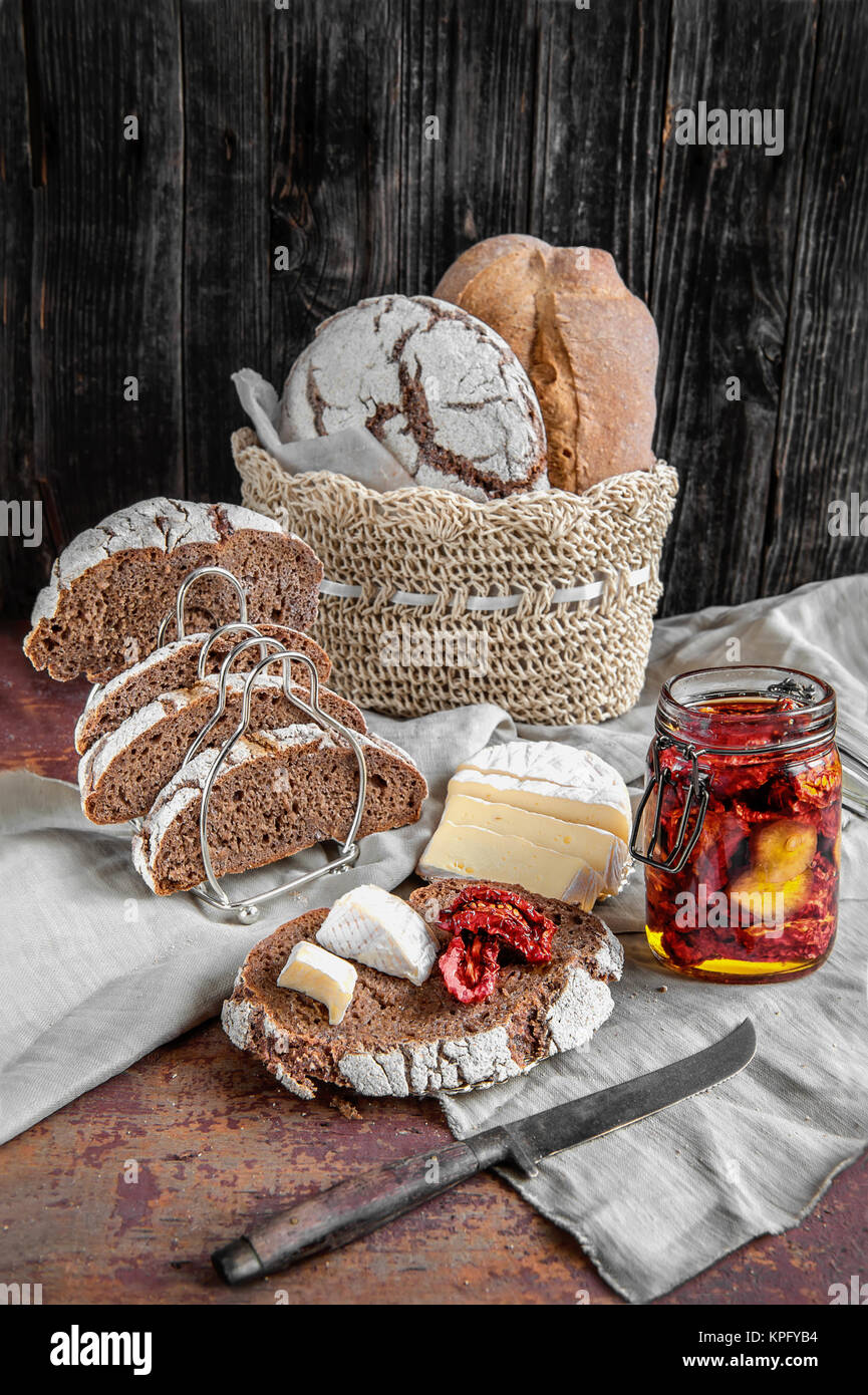 Bread whole wheat leavened handmade cheese and sun-dried tomatoes. Stock Photo