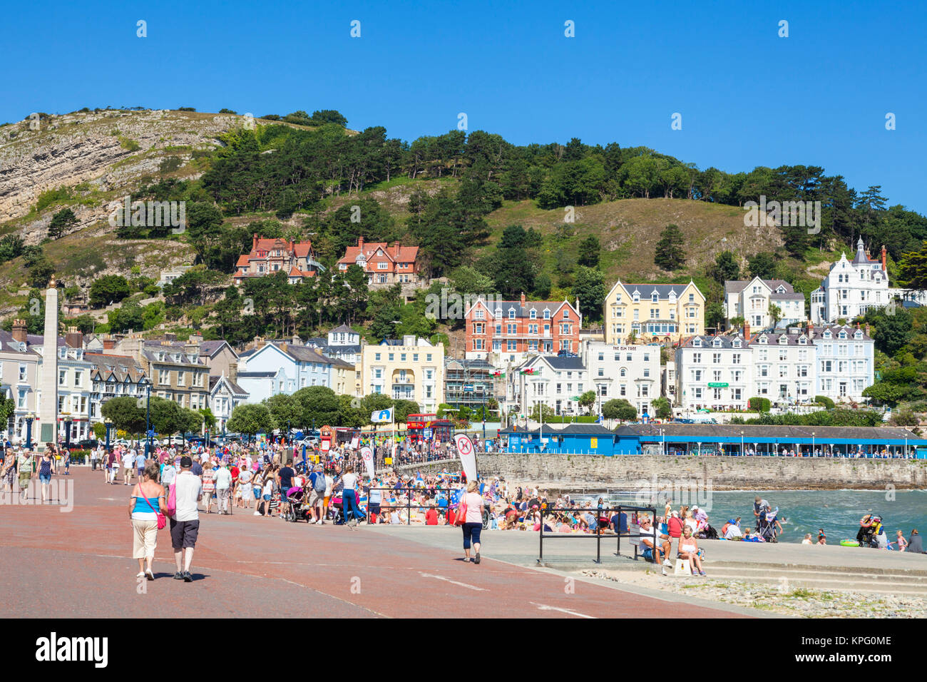 north wales llandudno north wales tourists and holidaymakers on the sandy beach at llandudno seafront on a summers - Stock Image
