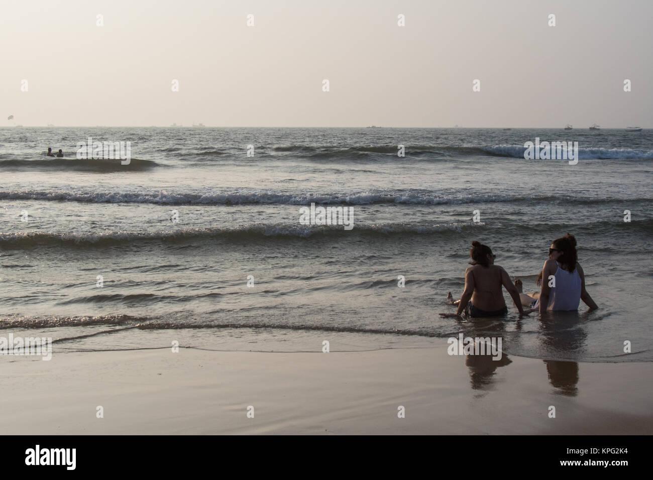 Tourists enjoying in waters at Calangute beach, Goa - Stock Image