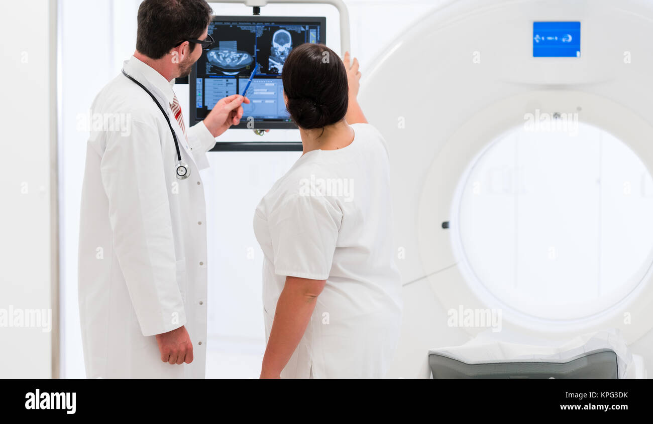 doctor,patient and nurse at ct tompgraphie in hospital,picture by the tube of the device Stock Photo