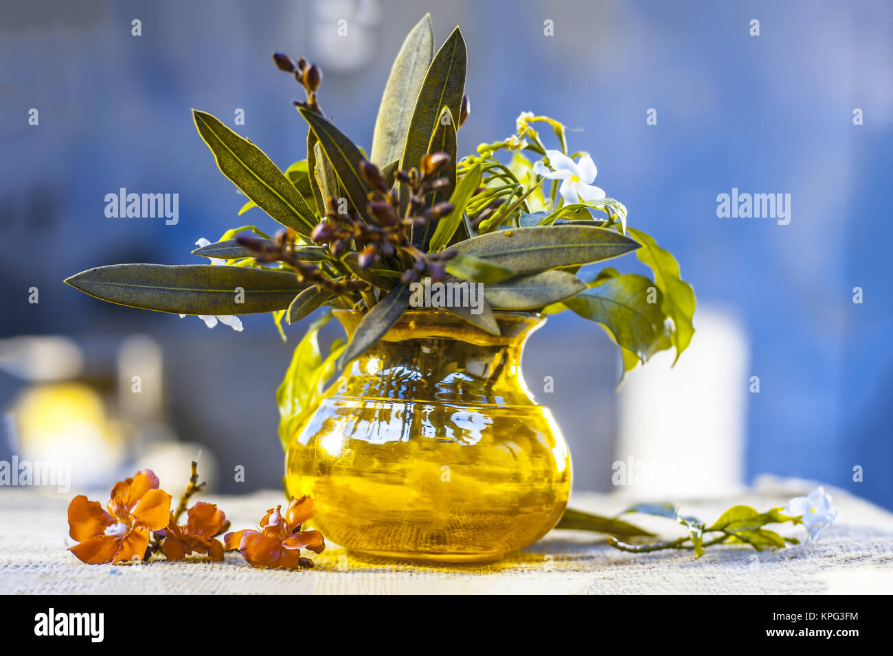 White Colored Aromatic Flower In A Broken Yellow Vase Stock Photo