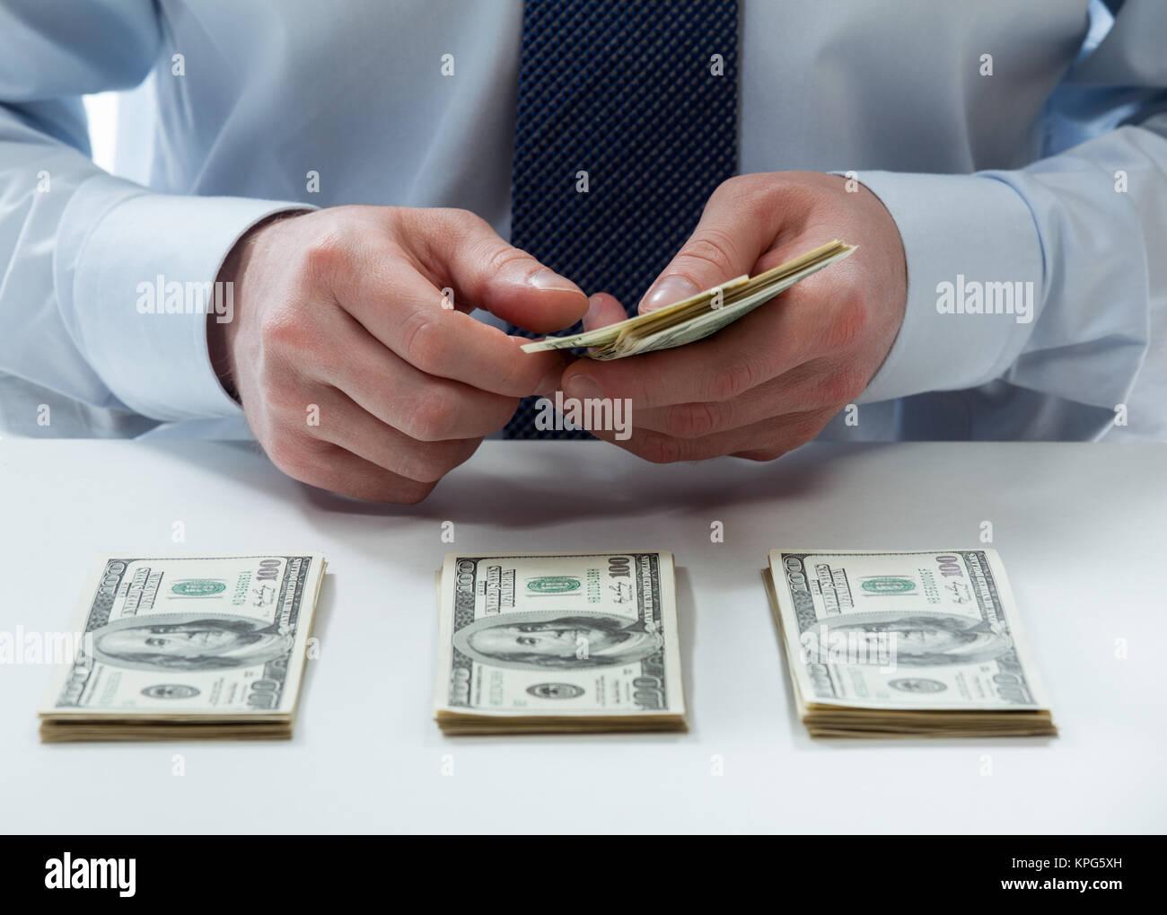 Bank teller counting dollar banknotes - Stock Image